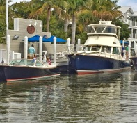 A fun look at the varying sizes of Hinckley Yachts, pictured are a Talaria 29R and Talaria 48 Flybridge.